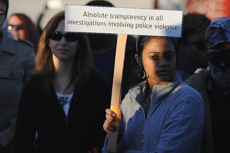 Protesters demonstrate on January 19, 2015, outside the Ferguson Police Department in Ferguson, Missouri (AFP Photo/Michael B. Thomas)