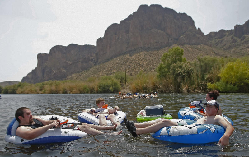 Tubers float down the Salt River on Saturday, June 29, 2013, in Phoenix. Excessive heat warnings will continue for much of the Desert Southwest as building high pressure triggers major warming in eastern California, Nevada, and Arizona. Temperature's are expected to get as high as 118 degrees. (AP Photo/Rick Scuteri)