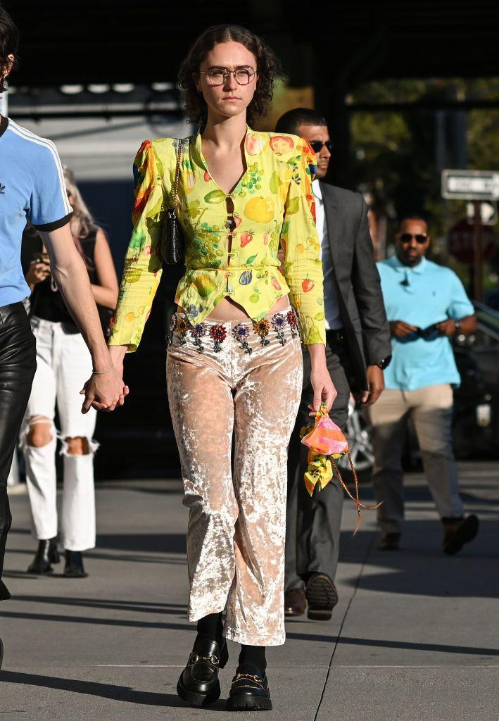 <p>Ella Emhoff pairs a jacket with velvet trousers to the Collina Strada SS22 show.</p>