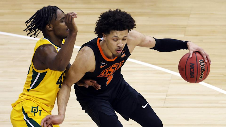 KANSAS CITY, MISSOURI - MARCH 12:  Cade Cunningham #2 of the Oklahoma State Cowboys controls the ball as Davion Mitchell #45 of the Baylor Bears defends during the Big 12 basketball tournament semifinal game at the T-Mobile Center on March 12, 2021 in Kansas City, Missouri. (Photo by Jamie Squire/Getty Images) ORG XMIT: 775629798 ORIG FILE ID: 1306775356