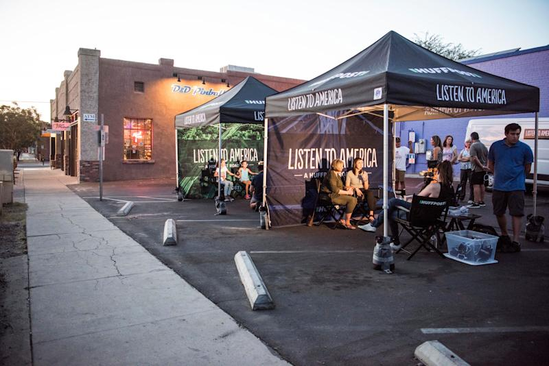 People are interviewed in tents in Tucson, Arizona.