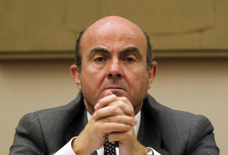Spain's Economy Minister Luis De Guindos gestures during a parliamentary hearing  at the Spanish Parliament, in Madrid, Spain, Monday, July 23, 2012. Economy Minister Luis de Guindos told reporters Monday before going into Parliament to discuss the rescue package for the banks that Spain would not need a bailout and said the intense market pressure was due to uncertainty over the future of the single euro currency. Financial pressure on recession-hit Spain ratcheted up further Monday to a level that has seen other European countries needing financial bailouts. (AP Photo/Andres Kudacki)