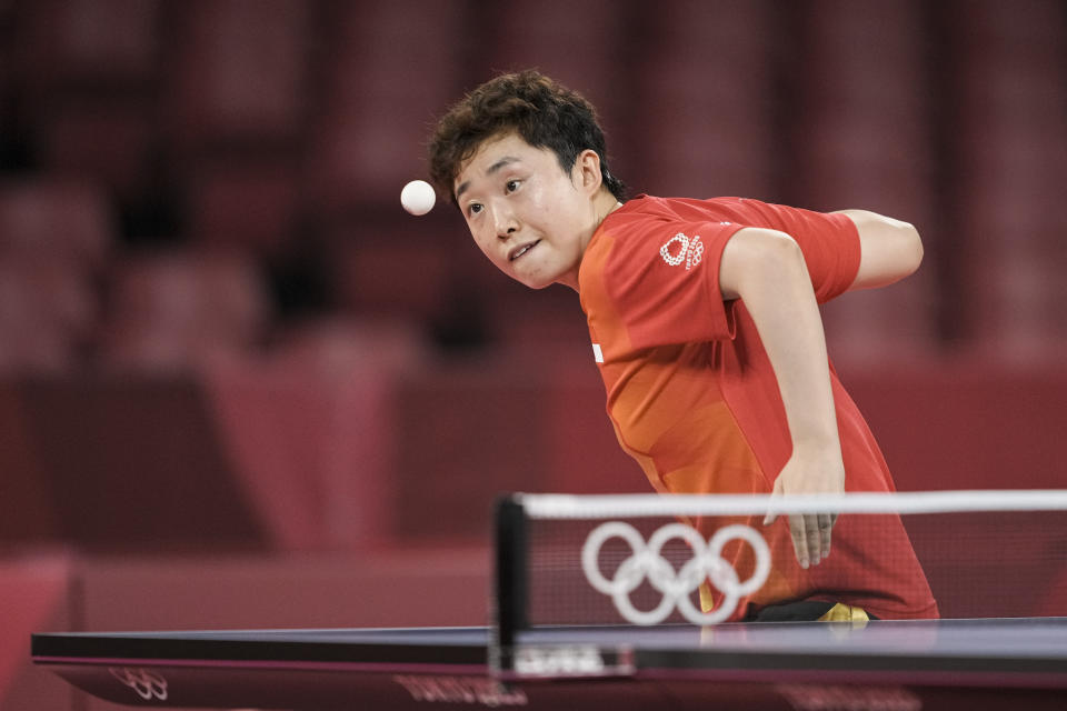 Singapore paddler Feng Tianwei in action against Spain's Maria Xiao in the women's singles competition at the 2020 Tokyo Olympics. (PHOTO: SNOC / Kong Chong Yew)