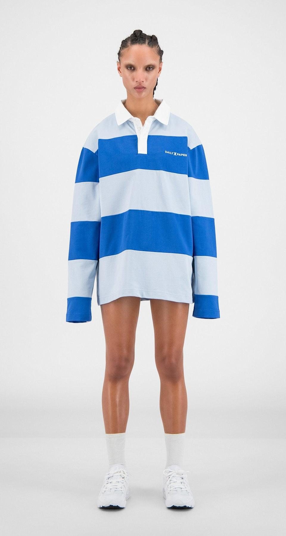 """Who's ready to take up rugby with us just so that we have an excuse to wear this shirt? <br> <br> <strong>Daily Paper</strong> Olympian Blue Striped Apolo Long-Sleeve, $, available at <a href=""""https://go.skimresources.com/?id=30283X879131&url=https%3A%2F%2Fwww.dailypaperclothing.com%2Fcollections%2Fwomen-all%2Fproducts%2Folympian-blue-striped-apolo-long-sleeve%3Fvariant%3D31248399106182"""" rel=""""nofollow noopener"""" target=""""_blank"""" data-ylk=""""slk:Daily Paper"""" class=""""link rapid-noclick-resp"""">Daily Paper</a>"""