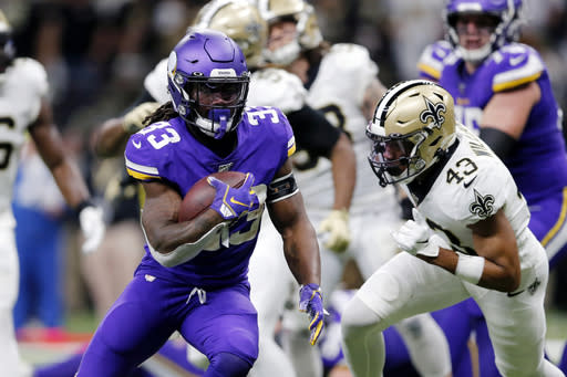 FILE - In this Jan. 5, 2020, file photo, Minnesota Vikings running back Dalvin Cook (33) carries for a touchdown in front of New Orleans Saints free safety Marcus Williams (43) during the first half of an NFL wild-card playoff football game in New Orleans. The Vikings are banking heavily on Cook this season, and he is counting on a new contract. (AP Photo/Brett Duke, File)