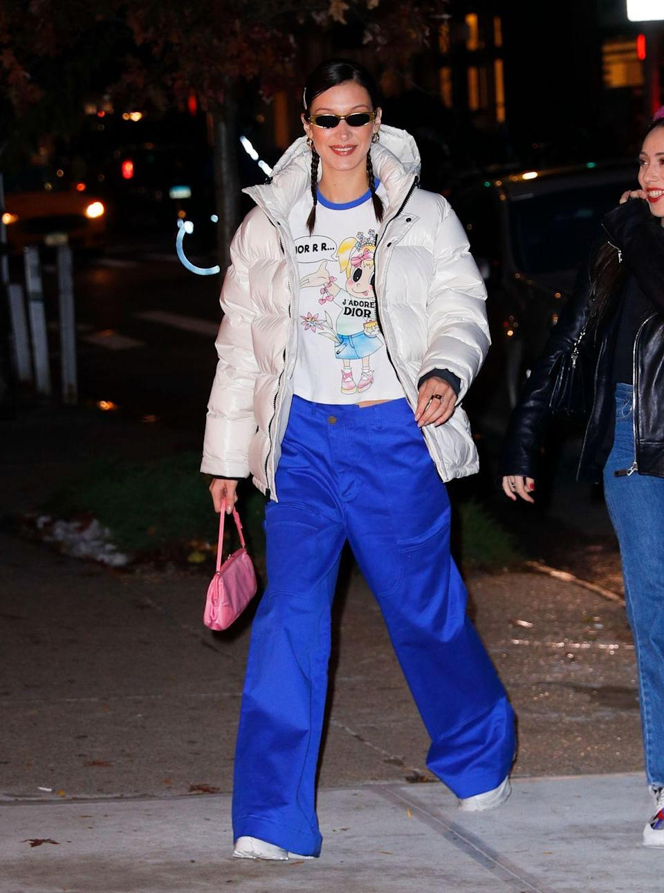 <p>Bella gets two spots on our list, because her layered style is just <em>that </em>good. If the Powerpuff girls needed to dress for wintertime, this is the look they'd pick: a girly puffer with '90s sunnies and bright blue pants straight out of a cartoon. </p>
