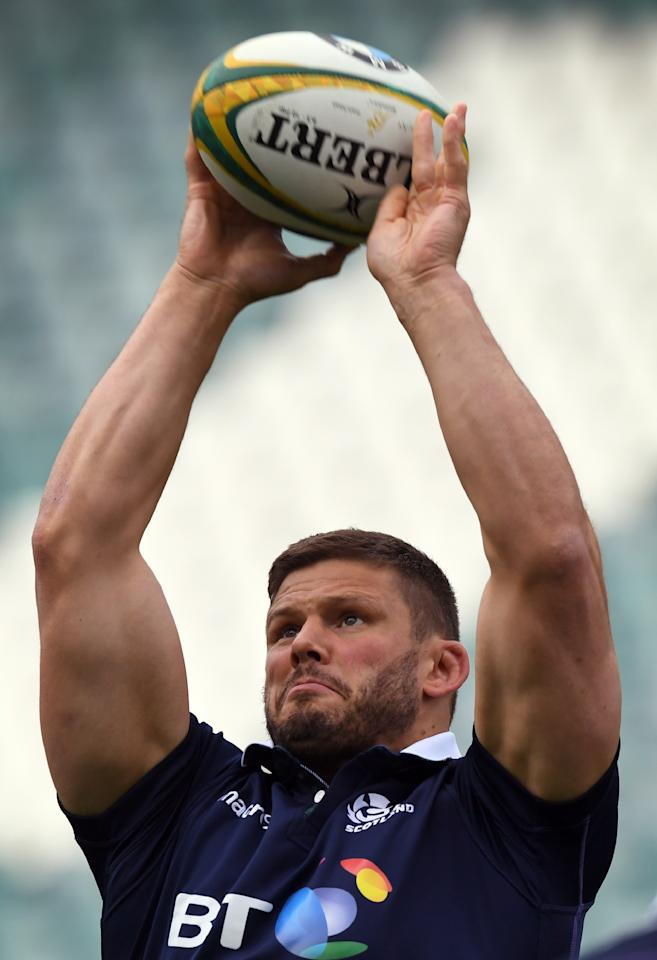 Scotland rugby player Ross Ford passes the ball during their Captain's Run in Sydney on June 16, 2017.Scotland plays Australia in a Test match in Sydney on June 17. (AFP Photo/WILLIAM WEST)