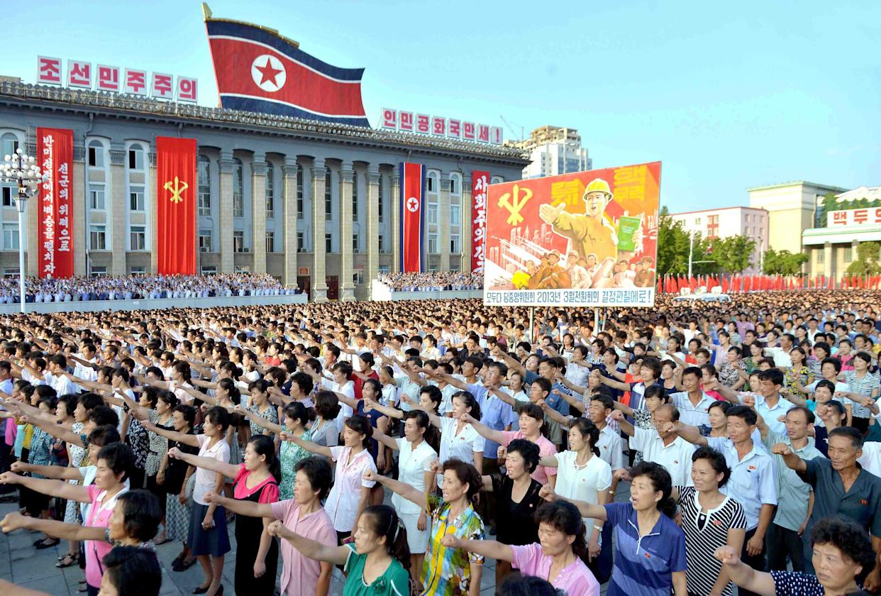 People participate in a Pyongyang city mass rally held at Kim Il Sung Square on August 9, 2017, to fully support the statement of the Democratic People's Republic of Korea (DPRK) government in this photo released on August 10, 2017.