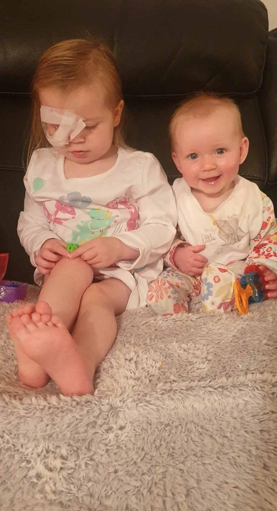 Evie seeing her sister Olivia again after four days in hospital. PA REAL LIFE COLLECT