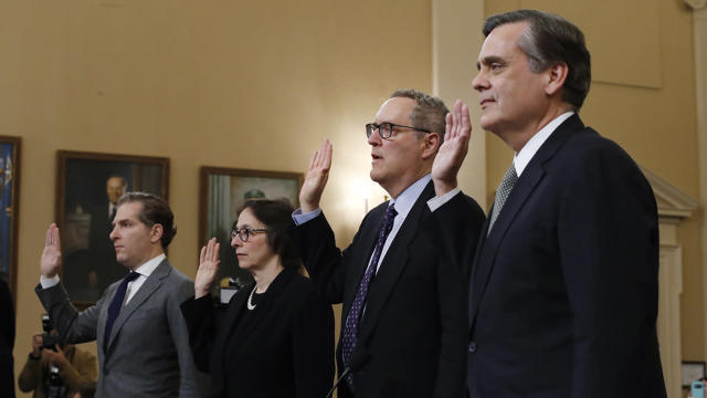 From left, constitutional law experts Noah Feldman of Harvard, Pamela Karlan of Stanford, Michael Gerhardt of UNC and Jonathan Turley of George Washington University are sworn in before testifying before the House Judiciary Committee. (Photo: Alex Brandon/AP)