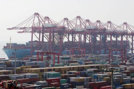 FILE PHOTO:Container ship is seen at the Yangshan Deep Water Port, part of the Shanghai Free Trade Zone, in Shanghai