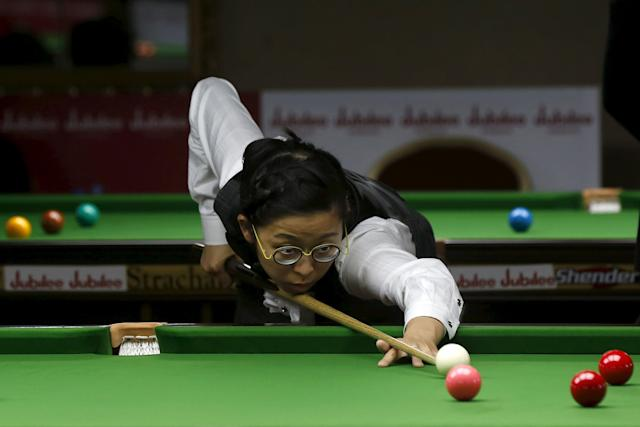 Hong Kong's Ng On Yee plays a shot during her snooker match against India's Suniti Damani (not seen) during the IBSF World 6 Red Snooker Championships in Karachi, Pakistan, August 8, 2015. REUTERS/Akhtar Soomro