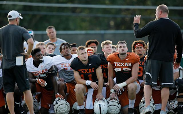 Texas Longhorns head coach Tom Herman (left) and head strength and conditioning coach Yancy McKnight (right) talk with the team after practice Wednesday Sept. 4, 2019 in Austin, Tx. ( Photo by Edward A. Ornelas )