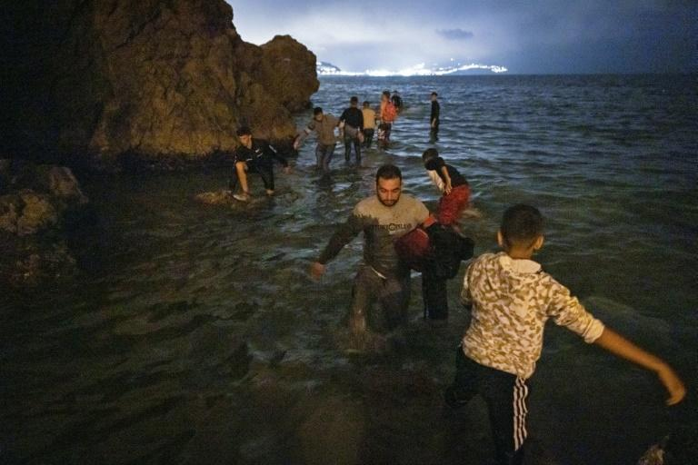 One migrant drowned as hundreds attempted to swim or wade along the coast to reach Spanish soil in Ceuta