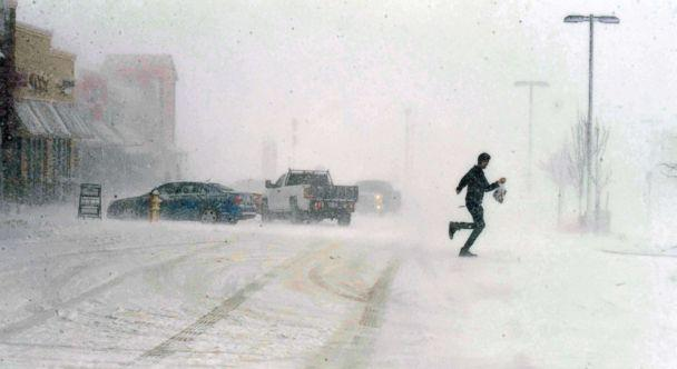 PHOTO: A man sprints to his car as he leaves the Sprouts grocery store on North Gate Blvd. in Colorado Springs, Colo., March 13, 2019. (Jerilee Bennett/The Gazette via AP)