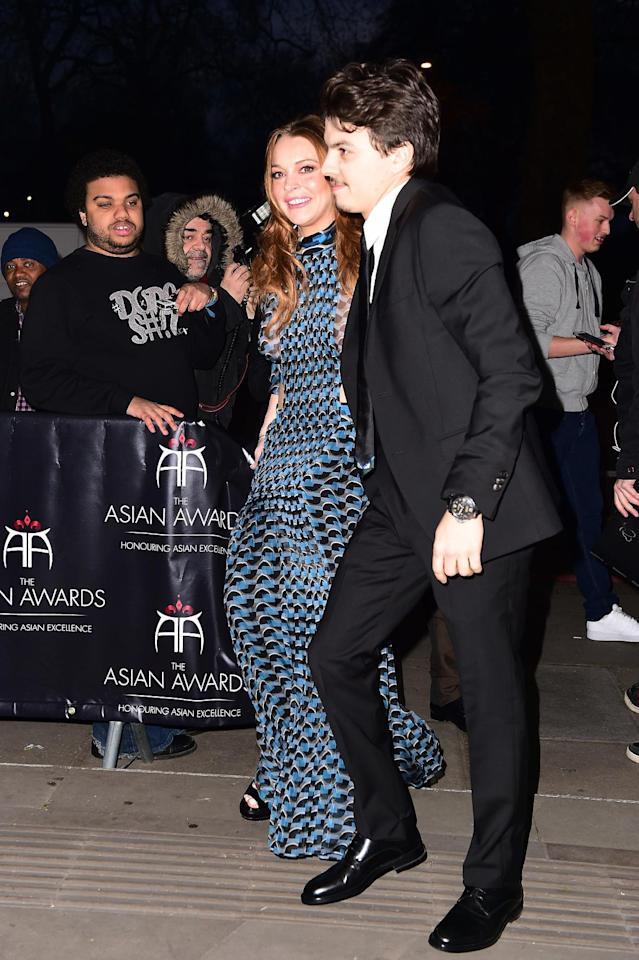 Actress Lindsay Lohan and her boyfriend Egor Tarabasov arrive at the 2016 British Asian Awards at a central London hotel, Friday, April 8, 2016. (Ian West/PA via AP) UNITED KINGDOM OUT - NO SALES - NO ARCHIVES
