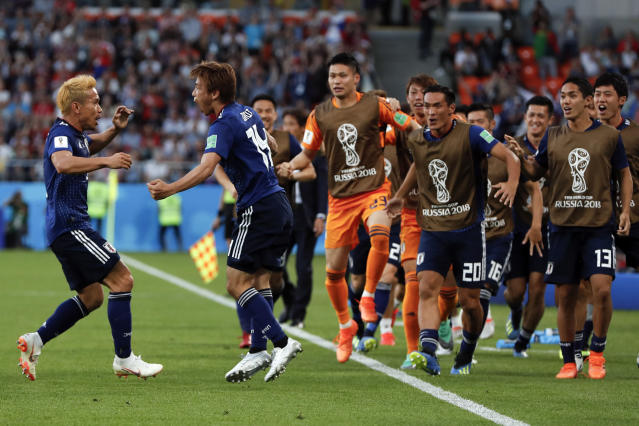 Japan's Takashi Inui, 2nd from left, celebrates with Yuto Nagatomo, left, and teammates after he scored his side's first goal during the group H match between Japan and Senegal at the 2018 soccer World Cup at the Yekaterinburg Arena in Yekaterinburg , Russia, Sunday, June 24, 2018. (AP Photo/Natacha Pisarenko)