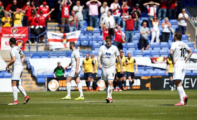 """Soccer Football - National League Play-Off Semi Final - Tranmere Rovers vs Ebbsfleet United - Prenton Park, Birkenhead, Britain - May 5, 2018 Tranmere Rovers players look dejected Action Images/Craig Brough EDITORIAL USE ONLY. No use with unauthorized audio, video, data, fixture lists, club/league logos or """"live"""" services. Online in-match use limited to 75 images, no video emulation. No use in betting, games or single club/league/player publications. Please contact your account representative for further details."""