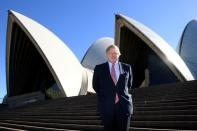 FILE PHOTO: British Foreign Secretary Boris Johnson stands on the steps of the Sydney Opera House during an official visit in Sydney, Australia