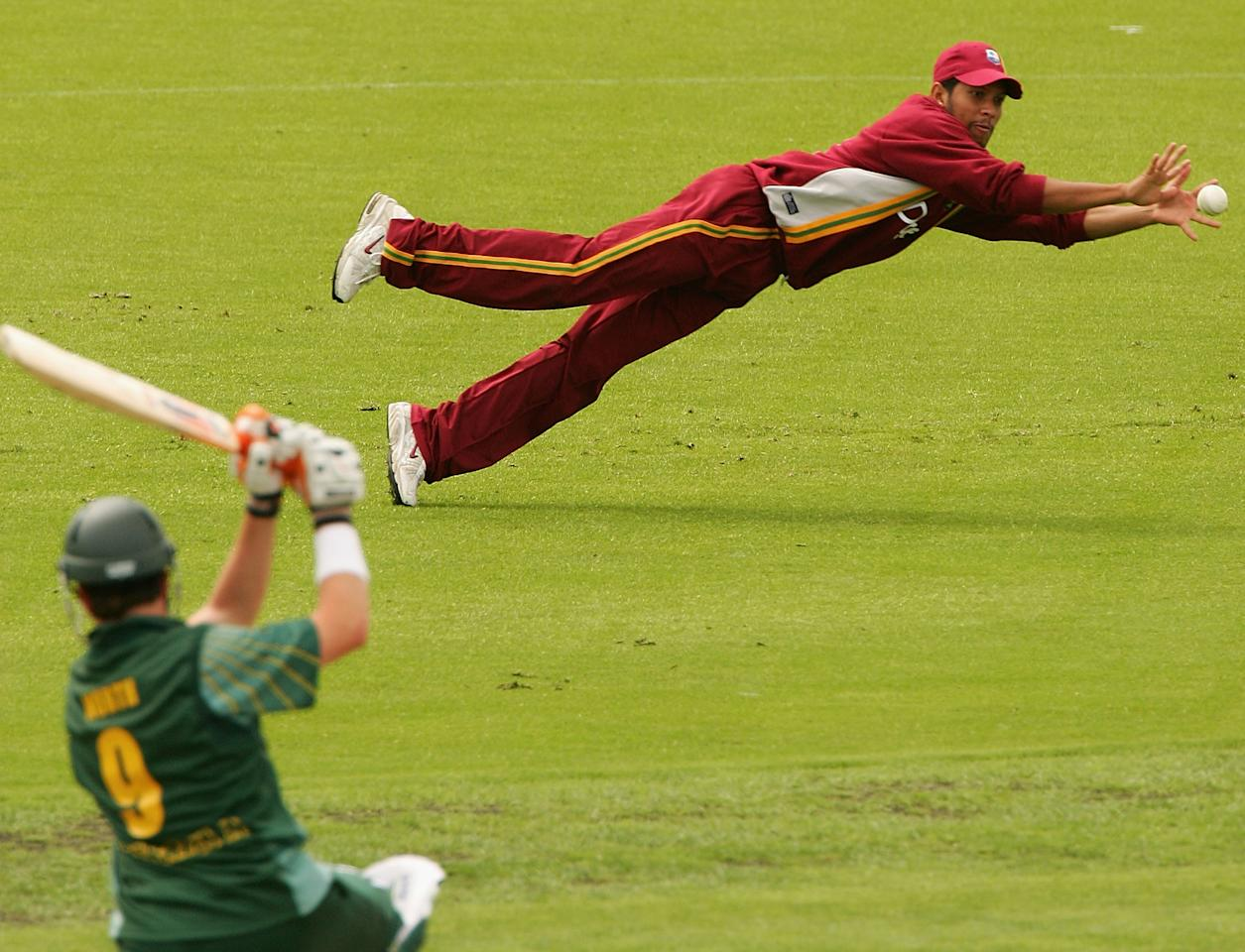 HOBART, AUSTRALIA - JANUARY 8:  Ramnaresh Sarwan of the West Indies dives to catch Marcus North of Australia A during the One Day Match between Australia A and the West Indies played at Bellerive Oval on January 8, 2005 in Hobart, Australia.  (Photo by Hamish Blair/Getty Images)