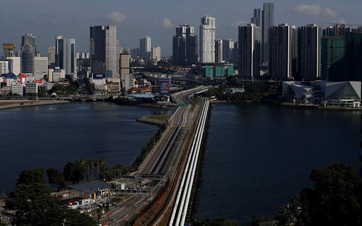 A view of the empty Woodlands Causeway between Singapore and Malaysia - Reuters