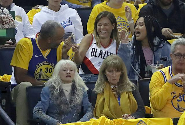 Dell and Sonya Curry are trying as hard as they can to avoid taking sides. (AP Photo/Jeff Chiu)