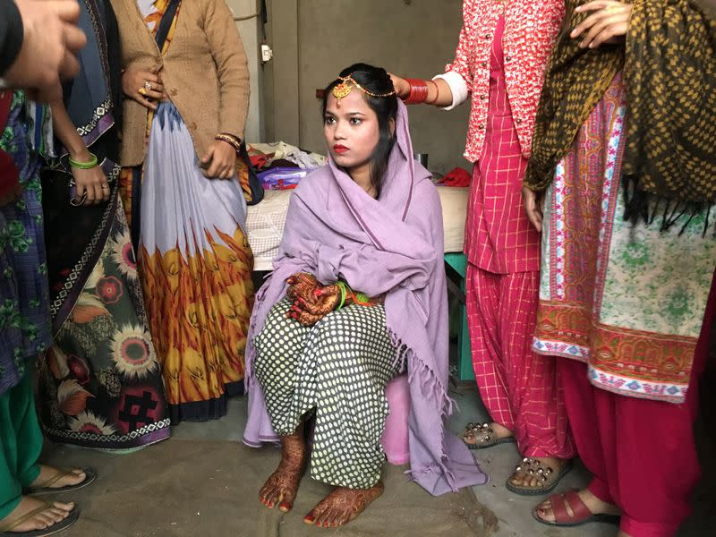 Savitri Prasad sits in her parents' home before taking her wedding vows in a riot affected area following clashes between people demonstrating for and against a new citizenship law in New Delhi