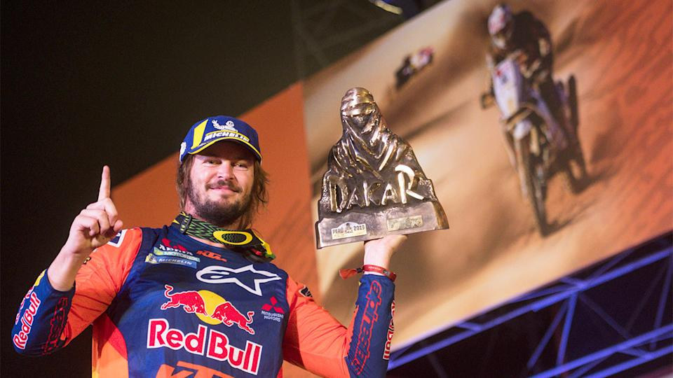Toby Price is pictured here with the 2019 Dakar Rally trophy.
