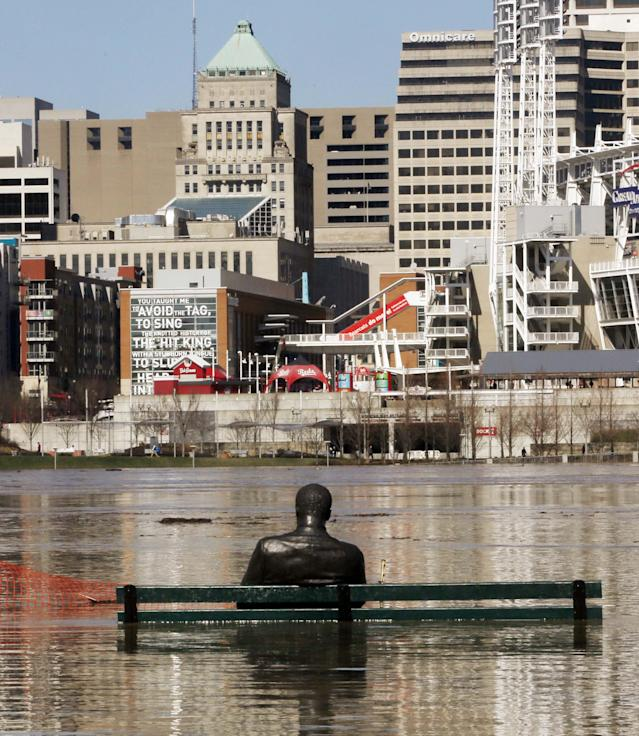 <p>The Stature of James Bradley and trash can are almost covered by the waters of the Ohio River in Cincinnati as the river floods the anks of Covington, Ky., and Cincinnati, Ohio on Monday, Feb. 26, 2018. (Photo: Ernest Coleman via ZUMA Wire) </p>