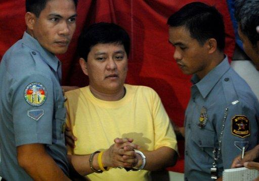 Detained Maguindanao massacre suspect Andal Ampatuan Jnr. (C) is escorted by policemen back to his cell in Manila. Andal Ampatuan Jnr, allegedly led his family's private army in stopping a convoy carrying the wife and relatives of a political rival, lawyers and a group of 32 journalists, and then gunning them down on a grassy hill
