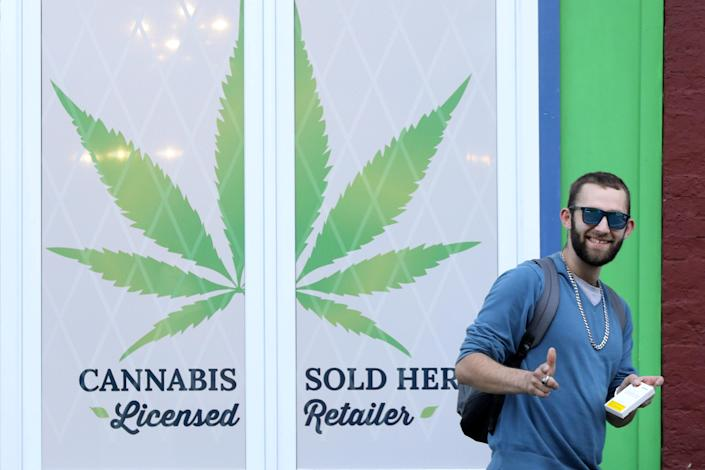 <p>A customer holding a cannabis product gestures while leaving the Natural Vibe store after legal recreational marijuana went on sale in St John's, Newfoundland and Labrador, Canada, Oct. 17, 2018. (Photo: Chris Wattie/Reuters) </p>