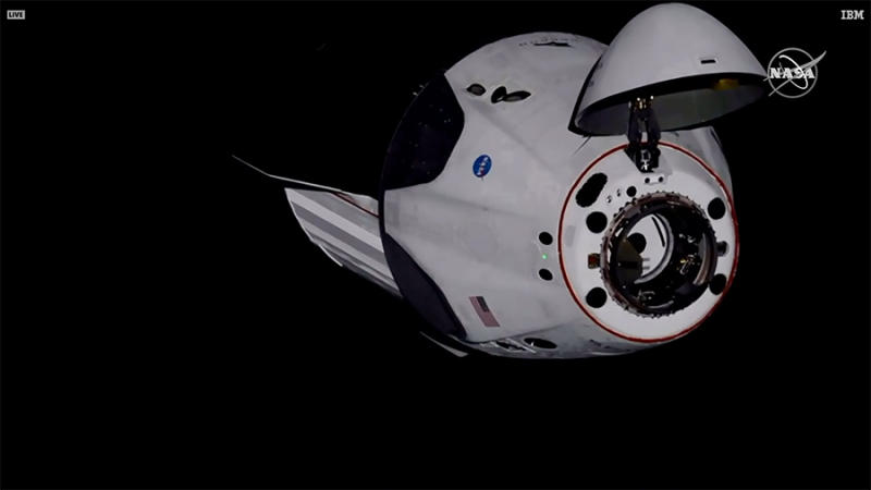 In this image provided by NASA, the SpaceX Dragon crew capsule, with NASA astronauts Doug Hurley and Robert Behnken aboard, docks with the International Space Station Sunday, May 31, 2020. It was the first time a privately built and owned spacecraft carried astronauts to the orbiting lab in its nearly 20 years. (NASA TV via AP)