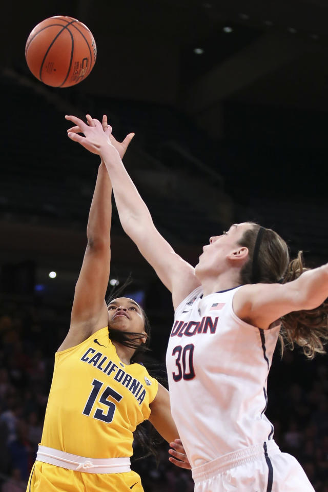 California guard Brittany Boyd (15) is blocked by Connecticut forward Breanna Stewart (30) during the first half of their NCAA college basketball game as part of the Maggie Dixon Basketball Classic at Madison Square Garden, Sunday, Dec. 22, 2013, in New York. (AP Photo/John Minchillo)