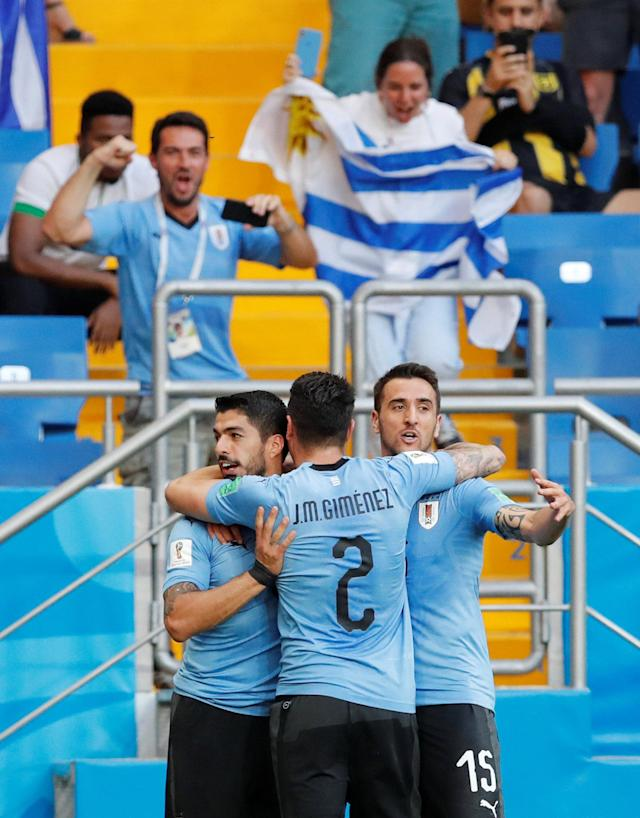 Soccer Football - World Cup - Group A - Uruguay vs Saudi Arabia - Rostov Arena, Rostov-on-Don, Russia - June 20, 2018 Uruguay's Luis Suarez celebrates with Jose Gimenez and Matias Vecino after scoring their first goal REUTERS/Carlos Garcia Rawlins