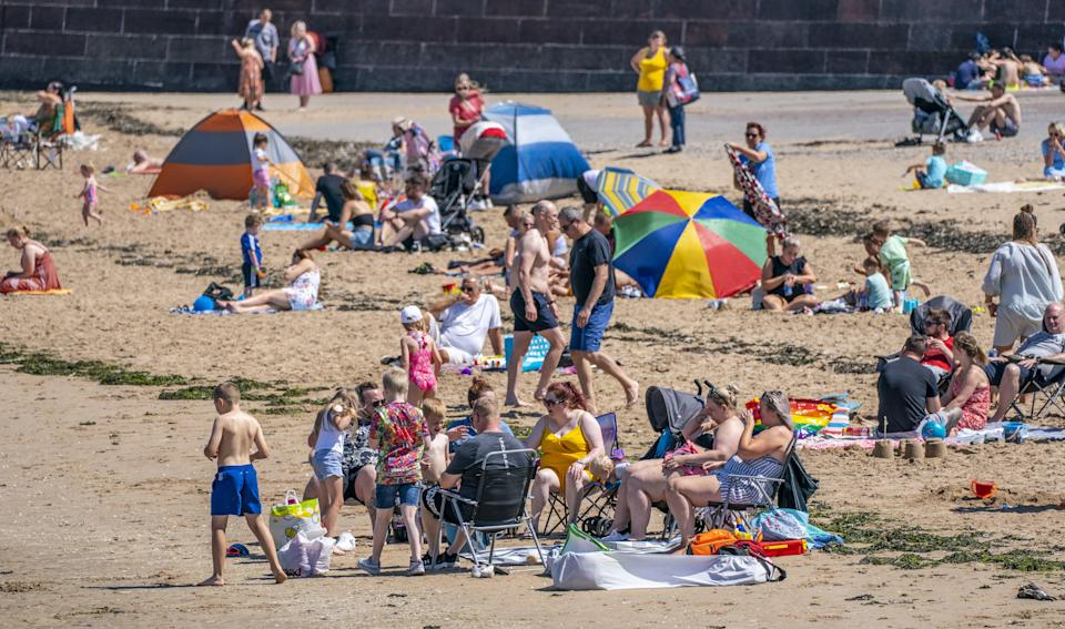 The sea breeze gave families a chance to cool down (Peter Byrne/PA) (PA Wire)