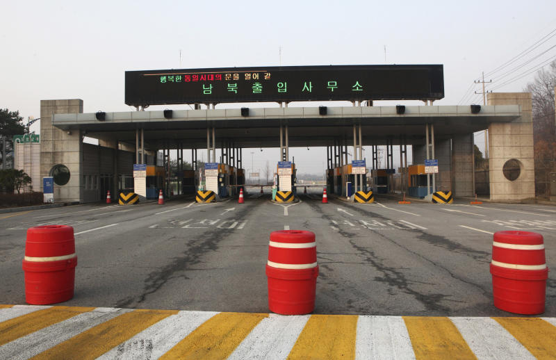 "The gateways to the North Korea's city of Kaesong are shut down at the Inter-Korean Transit Office in Paju, South Korea, near the border village of Panmunjom, Thursday, April 4, 2013. North Korea on Wednesday barred South Korean workers from entering a jointly run factory park just over the heavily armed border in the North, officials in Seoul said, a day after Pyongyang announced it would restart its long-shuttered plutonium reactor and increase production of nuclear weapons material. The letters at top read "" Inter-Korean Transit Office."" (AP Photo/Ahn Young-joon)"