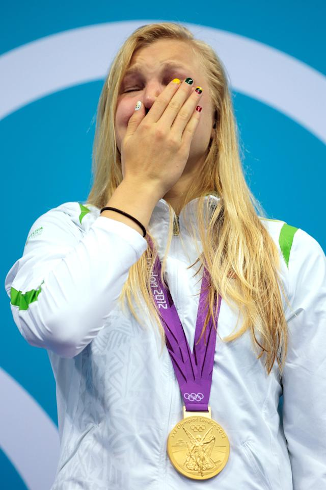 LONDON, ENGLAND - JULY 30: Ruta Meilutyte of Lithuania reacts as she receives her gold medal during the medal ceremony for the Women's 100m Breaststroke on Day 3 of the London 2012 Olympic Games at the Aquatics Centre on July 30, 2012 in London, England. (Photo by Adam Pretty/Getty Images)