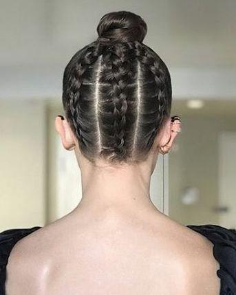 <p>Millie Bobby Brown channelled Dior at this year's Golden Globes with a seriously slick bun that revealed a secret trio of braids at the back. Created by celeb hairstylist Blake Erik, the plaited updo added a sneaky bit of unexpected to the actress' pared back black ensemble.</p>