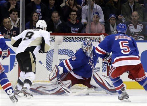 Pittsburgh Penguins' Pascal Dupuis (9), left, scores through the legs of New York Rangers goalie Henrik Lundqvist, center, during the second period of the NHL hockey game in New York, Sunday, Jan. 20, 2013. Lundqvist was replaced after this goal with the Rangers back-up goalie, Martin Biron. (AP Photo/Seth Wenig)