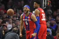 Detroit Pistons guard Bruce Brown, left, celebrates after scoring and drawing a foul as forward Christian Wood stands by during the first half of an NBA basketball game against the Los Angeles Clippers Thursday, Jan. 2, 2020, in Los Angeles. (AP Photo/Mark J. Terrill)