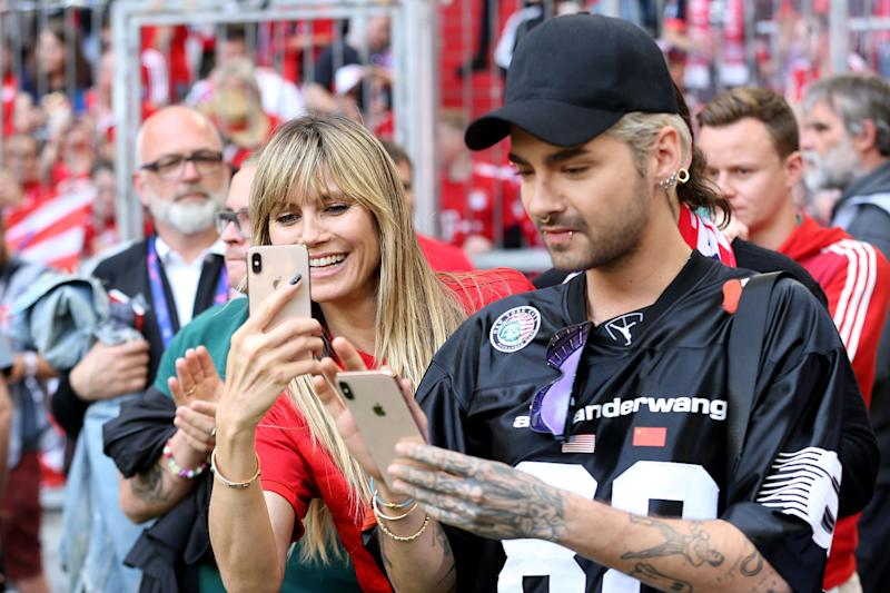 MUNICH, GERMANY - MAY 18: Heidi Klum and Bill Kaulitz look on prior to the Bundesliga match between FC Bayern Muenchen and Eintracht Frankfurt at Allianz Arena on May 18, 2019 in Munich, Germany. (Photo by TF-Images/Getty Images)