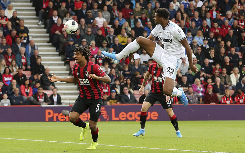 West Ham United's Sebastien Haller attempts a shot on goal against Bournemouth during their English Premier League soccer match at the Vitality Stadium in Bournemouth, England, Saturday, Sept. 28, 2019. (Mark Kerton/PA via AP)