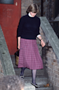 <p>Leaving the Young England kindergarten in Pimlico, this pleated skirt and jumper look, with each of the sleeves pushed up, is what the future Princess wore when she worked as a teacher.</p>