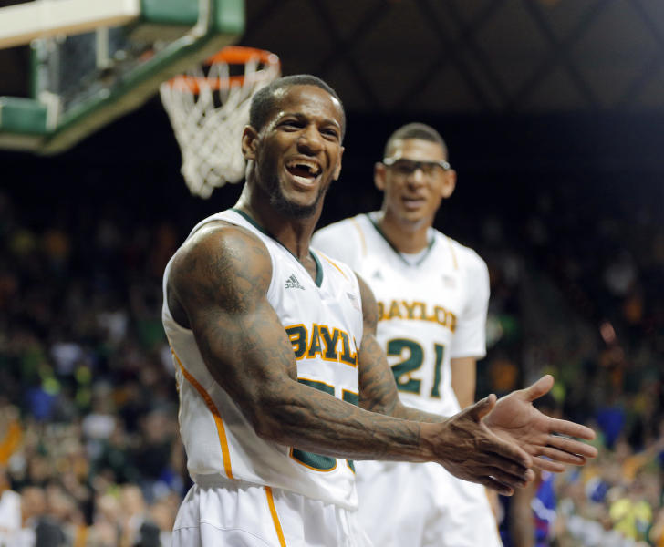 Baylor's senior Pierre Jackson, front, and Isaiah Austin (21) react to a foul by Kansas in the second half of a NCAA college basketball game, Saturday, March 9, 2013, in Waco, Texas. Baylor won 81-58. (AP Photo/Waco Tribune Herald, Rod Aydelotte)