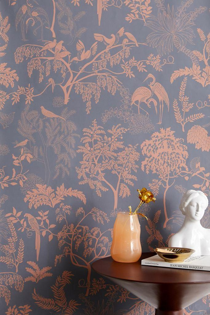 """In addition to stocking eclectic apparel and housewares, Urban Outfitters also stocks unique wallpaper. This removable wallpaper, with its weeping branches and regal birds, is made of cotton and is available in gray and coral (pictured) or black and white. $49, Urban Outfitters. <a href=""""https://www.urbanoutfitters.com/shop/birds-in-trees-toile-removable-wallpaper"""" rel=""""nofollow noopener"""" target=""""_blank"""" data-ylk=""""slk:Get it now!"""" class=""""link rapid-noclick-resp"""">Get it now!</a>"""