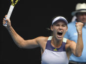Denmark's Caroline Wozniacki celebrates after defeating Dayana Yastremska of Ukraine in their second round singles match at the Australian Open tennis championship in Melbourne, Australia, Wednesday, Jan. 22, 2020. (AP Photo/Andy Brownbill)
