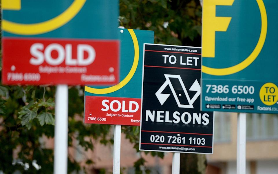 Letting and estate agents signs outside flats on the Old Kent Road in London - Anthony Devlin/PA