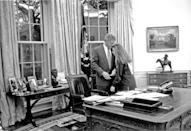 <p>Bill Clinton's daughter, Chelsea, visits her father in the Oval Office during his first term as President in 1993. </p>