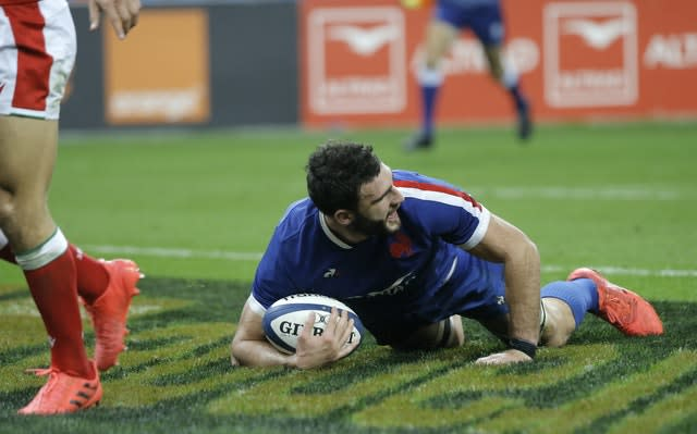 France captain Charles Ollivon celebrates after scoring a try