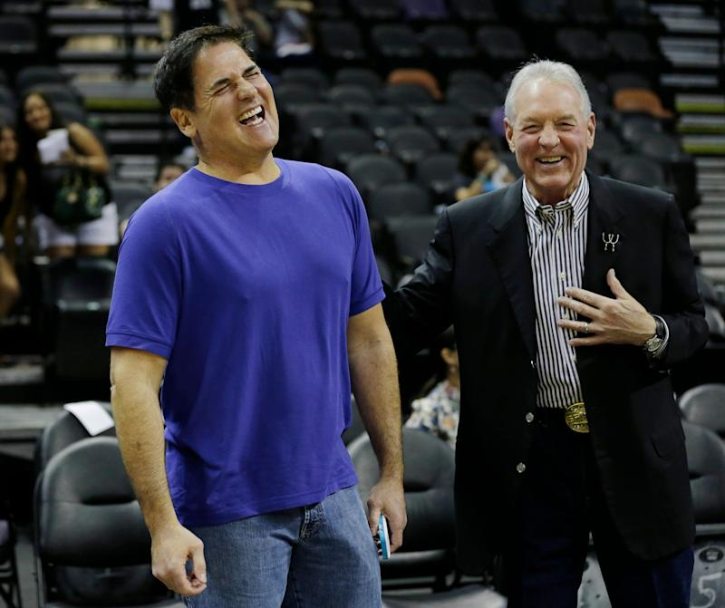 Dallas Mavericks owner Mark Cuban, left, and San Antonio Spurs owner Peter Holt, right, laugh before Game 2 of the opening-round NBA basketball playoff series on Wednesday, April 23, 2014, in San Antonio. (AP Photo/Eric Gay)